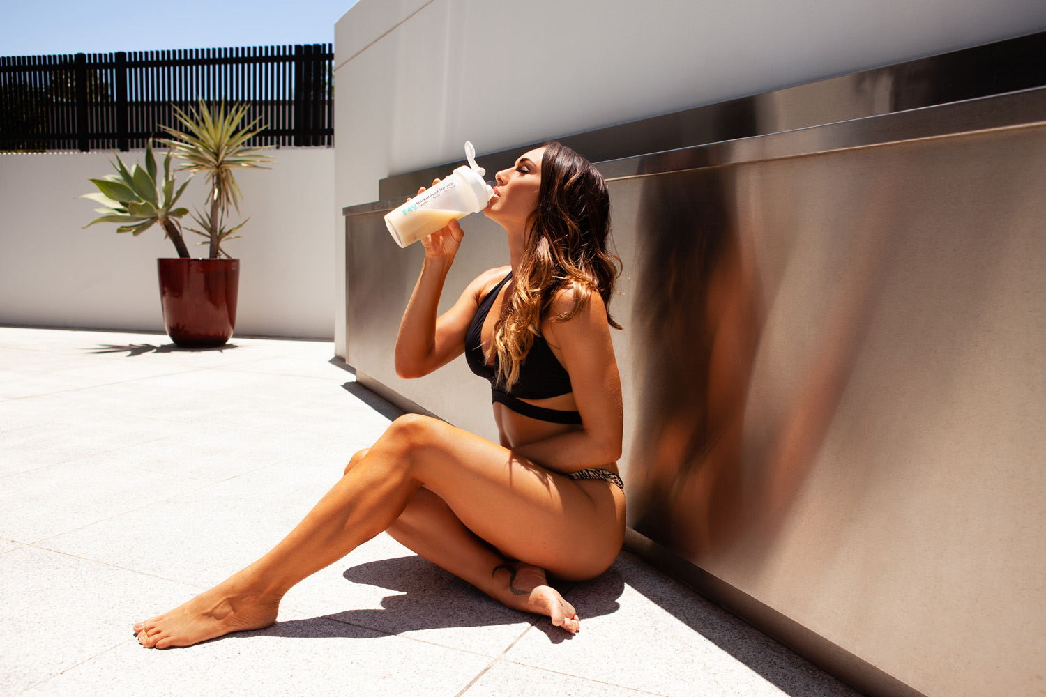 Fitness model in a bikini with a health drink, fitness model with green eyes, Fitness model in a bikini, qca photographer, queensland college of art photography graduate, queensland college of art photography, queensland college of art masters degree, queensland college of art graduate, model sitting at the pool, gold coast swimwear photography, gold coast model photography, instagram model photography, gold coast instagram model, gold coast instagram photography, gold coast fashion photography, lana noir, surfers paradise photography, broadbeach photographer, robina photographer, professional model photography, gold coast professional model, gold coast lifestyle photography, gold coast fitness photography, gold coast health photography, gold coast healthy living, gold coast healthy lifestyle, gold coast fitness
